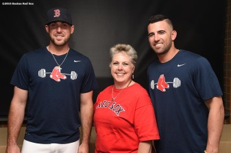 June 22, 2016, Boston, MA: A fan poses for a photograph with Boston Red Sox infielders Deven Marrero and Travis Shaw during the Girls of Summer event at Fenway Park in Boston, Massachusetts Tuesday, June 22, 2016. (Photo by Billie Weiss/Boston Red Sox)