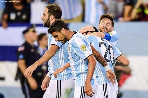 FOXBORO, MASSACHUSETTS - JUNE 18: Lionel Messi of Argentina reacts with teammates after scoring a goal during a Quarterfinal match between Argentina and Venezuela at Gillette Stadium as part of Copa America Centenario US 2016 on June 18, 2016 in Foxboro, Massachusetts, US. (Photo by Billie Weiss/LatinContent/Getty Images)