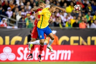 FOXBORO, MASSACHUSETTS - JUNE 12: Miranda of Brazil heads a ball as he is defended by Paolo Guerrero of Peru during a group B match between Brazil and Peru at Gillette Stadium as part of Copa America Centenario US 2016 on June 12, 2016 in Foxboro, Massachusetts, US. (Photo by Billie Weiss/LatinContent/Getty Images)