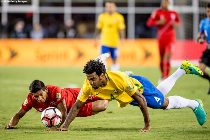 FOXBORO, MASSACHUSETTS - JUNE 12: Gil of Brazil and Renzo Revoredo of Peru dive for a ball during a group B match between Brazil and Peru at Gillette Stadium as part of Copa America Centenario US 2016 on June 12, 2016 in Foxboro, Massachusetts, US. (Photo by Billie Weiss/LatinContent/Getty Images)
