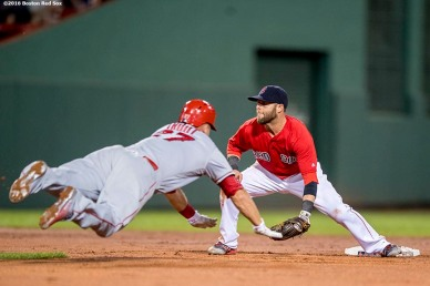 BOSTON, MA - JULY 1: Mike Trout #27 of the Los Angeles Angels of Anaheim dives as he steals second base and avoids the tag of Dustin Pedroia #15 of the Boston Red Sox during the seventh inning of a game on July1, 2016 at Fenway Park in Boston, Massachusetts. (Photo by Billie Weiss/Boston Red Sox/Getty Images) *** Local Caption *** Mike Trout; Dustin Pedroia