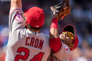 BOSTON, MA - JULY 3: C.J. Cron #24 and Gregorio Petit #8 of the Los Angeles Angels of Anaheim collide as Petit catches a fly ball during the fourth inning of a game against the Boston Red Sox on July 3, 2016 at Fenway Park in Boston, Massachusetts. (Photo by Billie Weiss/Boston Red Sox/Getty Images) *** Local Caption *** C.J. Cron; Gregorio Petit