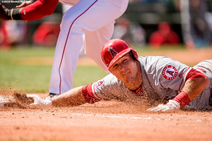 BOSTON, MA - JULY 3: Mike Trout #27 of the Los Angeles Angels of Anaheim slides back to avoid a pick off tag during the fourth inning of a game against the Boston Red Sox on July 3, 2016 at Fenway Park in Boston, Massachusetts. (Photo by Billie Weiss/Boston Red Sox/Getty Images) *** Local Caption *** Mike Trout