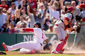 BOSTON, MA - JULY 3: Hanley Ramirez #13 of the Boston Red Sox slides as avoids the tag of Jett Bandy #47 of the Los Angeles Angels of Anaheim to score during the fifth inning of a game on July 3, 2016 at Fenway Park in Boston, Massachusetts. (Photo by Billie Weiss/Boston Red Sox/Getty Images) *** Local Caption *** Hanley Ramirez; Jett Bandy