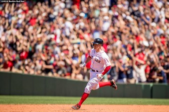 BOSTON, MA - JULY 4: Brock Holt #12 of the Boston Red Sox rounds the bases after hitting a two run home run during the third inning of a game against the Texas Rangers on July 4, 2016 at Fenway Park in Boston, Massachusetts. (Photo by Billie Weiss/Boston Red Sox/Getty Images) *** Local Caption *** Brock Holt