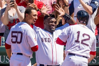 BOSTON, MA - JULY 4: Brock Holt #12 of the Boston Red Sox high fives David Ortiz #34 and Mookie Betts #50 after hitting a two run home run during the third inning of a game against the Texas Rangers on July 4, 2016 at Fenway Park in Boston, Massachusetts. (Photo by Billie Weiss/Boston Red Sox/Getty Images) *** Local Caption *** Brock Holt; David Ortiz; Mookie Betts