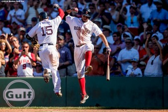 BOSTON, MA - JULY 4: Dustin Pedroia #15 of the Boston Red Sox high fives Xander Bogaerts #2 after hitting a solo home run during the seventh inning of a game against the Texas Rangers on July 4, 2016 at Fenway Park in Boston, Massachusetts. (Photo by Billie Weiss/Boston Red Sox/Getty Images) *** Local Caption *** Dustin Pedroia; Xander Bogaerts