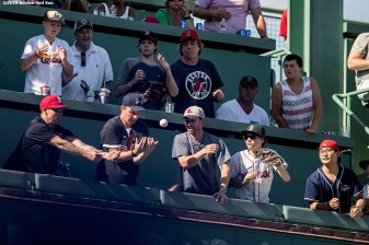 BOSTON, MA - JULY 4: A fan drops a home run ball on the green monster seats during a game between the Boston Red Sox and the Texas Rangers on July 4, 2016 at Fenway Park in Boston, Massachusetts. (Photo by Billie Weiss/Boston Red Sox/Getty Images) *** Local Caption ***