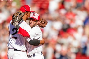 BOSTON, MA - JULY 4: Dustin Pedroia #15 and Xander Bogaerts #2 of the Boston Red Sox celebrate a victory against the Texas Rangers on July 4, 2016 at Fenway Park in Boston, Massachusetts. (Photo by Billie Weiss/Boston Red Sox/Getty Images) *** Local Caption *** Dustin Pedroia; Xander Bogaerts