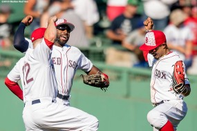 BOSTON, MA - JULY 4: Brock Holt #12, Jackie Bradley Jr. #25, and Mookie Betts #50 of the Boston Red Sox celebrate a victory against the Texas Rangers on July 4, 2016 at Fenway Park in Boston, Massachusetts. (Photo by Billie Weiss/Boston Red Sox/Getty Images) *** Local Caption *** Jackie Bradley Jr.; Brock Holt; Mookie Betts