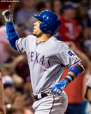 BOSTON, MA - JULY 5: Robinson Chirinos #61 of the Texas Rangers reacts after hitting a three run home run during the ninth inning of a game against the Boston Red Sox on July 5, 2016 at Fenway Park in Boston, Massachusetts. (Photo by Billie Weiss/Boston Red Sox/Getty Images) *** Local Caption *** Robinson Chirinos