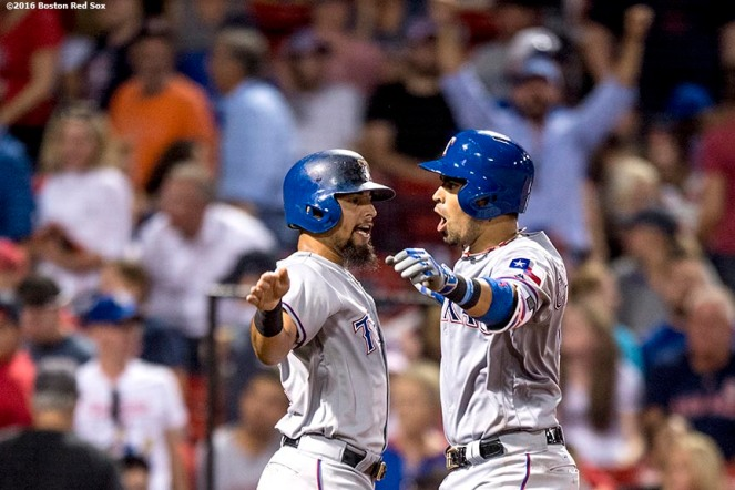 BOSTON, MA - JULY 5: Robinson Chirinos #61 of the Texas Rangers reacts with Rougned Odor #12 after hitting a three run home run during the ninth inning of a game against the Boston Red Sox on July 5, 2016 at Fenway Park in Boston, Massachusetts. (Photo by Billie Weiss/Boston Red Sox/Getty Images) *** Local Caption *** Robinson Chirinos; Rougned Odor