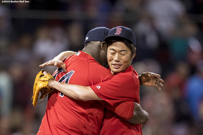 BOSTON, MA - JULY 8: David Ortiz #34 hugs Koji Uehara #19 of the Boston Red Sox following a victory against the Tampa Bay Rays on July 8, 2016 at Fenway Park in Boston, Massachusetts. (Photo by Billie Weiss/Boston Red Sox/Getty Images) *** Local Caption *** David Ortiz; Koji Uehara