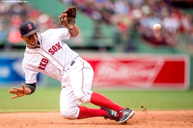 BOSTON, MA - JULY 8: Xander Bogaerts #2 of the Boston Red Sox fields a ground ball during the fifth inning of a game against the Tampa Bay Rays on July 9, 2016 at Fenway Park in Boston, Massachusetts. (Photo by Billie Weiss/Boston Red Sox/Getty Images) *** Local Caption *** Xander Bogaerts