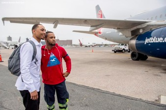 July 10, 2016, Boston, MA: Boston Red Sox right fielder Mookie Betts poses for a photograph with a jetBlue crew member before boarding the plane in Boston, Massachusetts Sunday, July 10, 2016 during a team charter flight to San Diego, California for the 2016 Major League Baseball All-Star Game. (Photos by Billie Weiss/Boston Red Sox)
