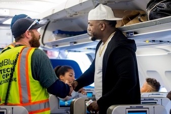 July 10, 2016, Boston, MA: Boston Red Sox designated hitter David Ortiz greets jetBlue crew members on the plane in Boston, Massachusetts Sunday, July 10, 2016 during a team charter flight to San Diego, California for the 2016 Major League Baseball All-Star Game. (Photos by Billie Weiss/Boston Red Sox)