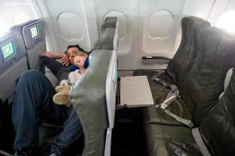 July 10, 2016, Boston, MA: Boston Red Sox pitcher Steven Wright sleeps on the plane with his daughter, Ella, in Boston, Massachusetts Sunday, July 10, 2016 during a team charter flight to San Diego, California for the 2016 Major League Baseball All-Star Game. (Photos by Billie Weiss/Boston Red Sox)