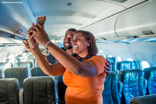 July 10, 2016, Boston, MA: Boston Red Sox center fielder Jackie Bradley Jr. poses for a selfie photograph with a flight attendant on the plane in Boston, Massachusetts Sunday, July 10, 2016 during a team charter flight to San Diego, California for the 2016 Major League Baseball All-Star Game. (Photos by Billie Weiss/Boston Red Sox)