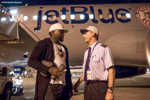 July 10, 2016, San Diego, CA: Boston Red Sox designated hitter David Ortiz talks with the captain after exiting the plane in San Diego, California Sunday, July 10, 2016 during a team charter flight to the 2016 Major League Baseball All-Star Game. (Photos by Billie Weiss/Boston Red Sox)