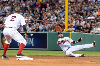 BOSTON, MA - JULY 19: Dustin Pedroia #15 of the Boston Red Sox throws to Xander Bogaerts #2 at second base after field a ground ball during the fifth inning of a game against the San Francisco Giants on July 19, 2016 at Fenway Park in Boston, Massachusetts. (Photo by Billie Weiss/Boston Red Sox/Getty Images) *** Local Caption *** Dustin Pedroia; Xander Bogaerts
