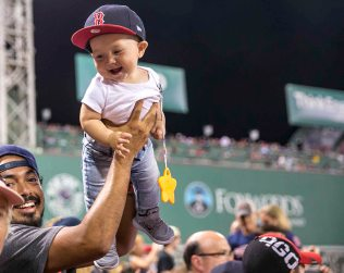 BOSTON, MA - JULY 19: A young fan during a game between the Boston Red Sox and the San Francisco Giants on July 19, 2016 at Fenway Park in Boston, Massachusetts. (Photo by Billie Weiss/Boston Red Sox/Getty Images) *** Local Caption ***