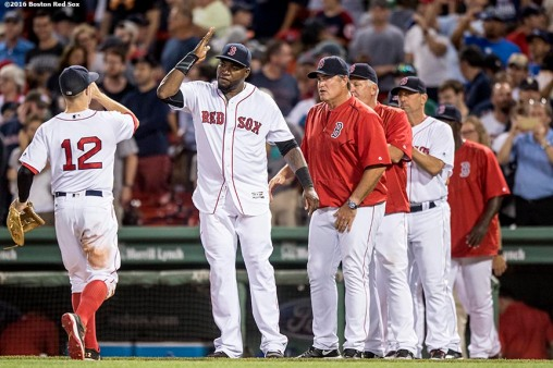 BOSTON, MA - JULY 19: Brock Holt #12 high fives David Ortiz #34 of the Boston Red Sox after a victory against the San Francisco Giants on July 19, 2016 at Fenway Park in Boston, Massachusetts. (Photo by Billie Weiss/Boston Red Sox/Getty Images) *** Local Caption *** Brock Holt; David Ortiz