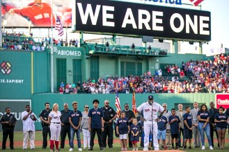 BOSTON, MA - JULY 19: David Ortiz #34 of the Boston Red Sox speaks during a Boston Police and Community Leaders ceremony before a game against the San Francisco Giants on July 19, 2016 at Fenway Park in Boston, Massachusetts. (Photo by Billie Weiss/Boston Red Sox/Getty Images) *** Local Caption *** David Ortiz