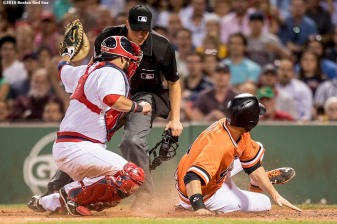 BOSTON, MA - JULY 20: Sandy Leon #3 of the Boston Red Sox tags out Brandon Belt #9 of the San Francisco Giants as he attempts to score during the sixth inning of a game on July 20, 2016 at Fenway Park in Boston, Massachusetts. (Photo by Billie Weiss/Boston Red Sox/Getty Images) *** Local Caption *** Sandy Leon; Brandon Belt