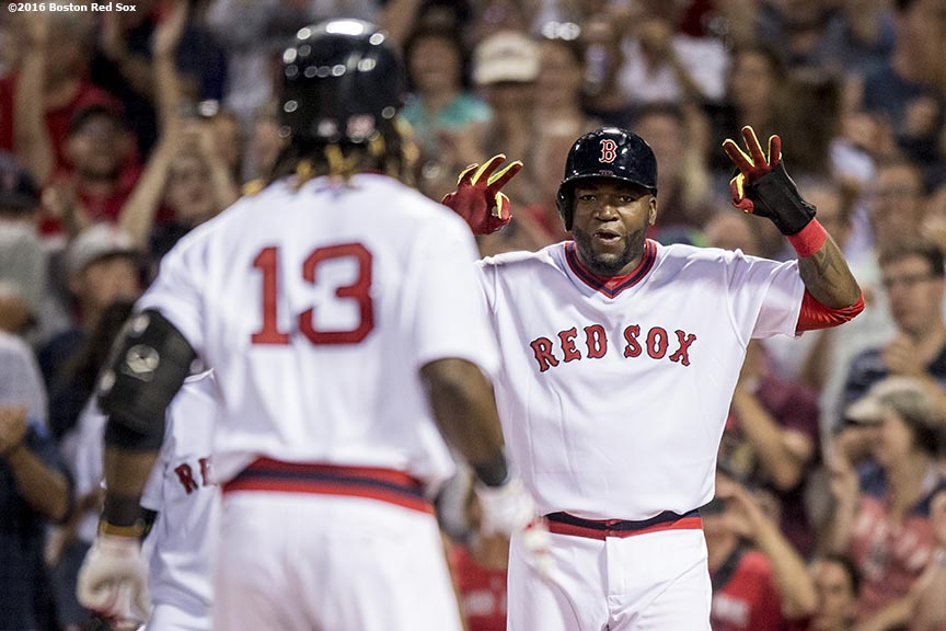 BOSTON, MA - JULY 20: David Ortiz #34 reacts as Hanley Ramirez #13 of the Boston Red Sox crosses home plate after hitting a two run home run during the sixth inning of a game against the San Francisco Giants on July 20, 2016 at Fenway Park in Boston, Massachusetts. It was his third home run of the game. (Photo by Billie Weiss/Boston Red Sox/Getty Images) *** Local Caption *** Hanley Ramirez; David Ortiz