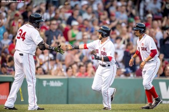 BOSTON, MA - JULY 21: Dustin Pedroia #15 and Mookie Betts #50 high five David Ortiz #34 of the Boston Red Sox as they score during the second inning of a game against the Minnesota Twins on July 21, 2016 at Fenway Park in Boston, Massachusetts. (Photo by Billie Weiss/Boston Red Sox/Getty Images) *** Local Caption *** Dustin Pedroia; Mookie Betts; David Ortiz,