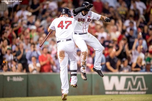 BOSTON, MA - JULY 21: Jackie Bradley Jr. #25 of the Boston Red Sox high fives Travis Shaw #47 after hitting a solo home run during the fifth inning of a game against the Minnesota Twins on July 21, 2016 at Fenway Park in Boston, Massachusetts. (Photo by Billie Weiss/Boston Red Sox/Getty Images) *** Local Caption *** Jackie Bradley Jr.; Travis Shaw