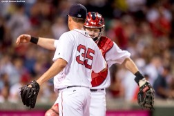 BOSTON, MA - JULY 21: Steven Wright #34 of the Boston Red Sox high fives Ryan Hanigan #10 during the eighth inning of a game against the Minnesota Twins on July 21, 2016 at Fenway Park in Boston, Massachusetts. (Photo by Billie Weiss/Boston Red Sox/Getty Images) *** Local Caption *** Steven Wright; Ryan Hanigan