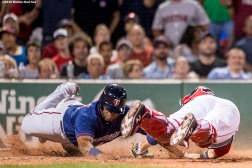 BOSTON, MA - JULY 23: Kennys Vargas #19 of the Minnesota Twins slides as he avoids the tag of Sandy Leon #3 of the Boston Red Sox to score the game tying run during the seventh inning of a game on July 23, 2016 at Fenway Park in Boston, Massachusetts. (Photo by Billie Weiss/Boston Red Sox/Getty Images) *** Local Caption *** Kennys Vargas; Sandy Leon