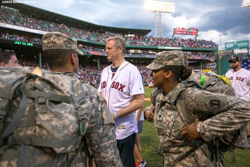 BOSTON, MA - JULY 23: Massachusetts Governor Charlie Baker is introduced before throwing out the ceremonial first pitch before a game between the Boston Red Sox and the Minnesota Twins on July 23, 2016 at Fenway Park in Boston, Massachusetts. (Photo by Billie Weiss/Boston Red Sox/Getty Images) *** Local Caption *** Charlie Baker