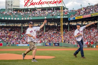 BOSTON, MA - JULY 23: Massachusetts Transit Police member Kurt Power and Massachusetts Governor Charlie Baker throw out the ceremonial first pitch before a game between the Boston Red Sox and the Minnesota Twins on July 23, 2016 at Fenway Park in Boston, Massachusetts. (Photo by Billie Weiss/Boston Red Sox/Getty Images) *** Local Caption *** Charlie Baker; Kurt Power