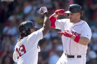 BOSTON, MA - JULY 24: Travis Shaw #47 of the Boston Red Sox high fives Hanley Ramirez #13 after hitting a home run during the fifth inning of a game against the Minnesota Twins on July 24, 2016 at Fenway Park in Boston, Massachusetts. (Photo by Billie Weiss/Boston Red Sox/Getty Images) *** Local Caption *** Travis Shaw; Hanley Ramirez