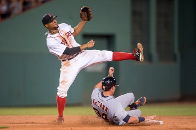 BOSTON, MA - JULY 25: Xander Bogaerts #2 of the Boston Red Sox reacts as he holds the ball after recording an out at second base during the seventh inning of a game against the Detroit Tigers on July 25, 2016 at Fenway Park in Boston, Massachusetts. (Photo by Billie Weiss/Boston Red Sox/Getty Images) *** Local Caption *** Xander Bogaerts