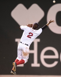 BOSTON, MA - JULY 25: Xander Bogaerts #2 of the Boston Red Sox reaches to catch a fly ball during the eighth inning of a game against the Detroit Tigers on July 25, 2016 at Fenway Park in Boston, Massachusetts. (Photo by Billie Weiss/Boston Red Sox/Getty Images) *** Local Caption *** Xander Bogaerts