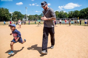July 26, 2016, Boston, MA: Boston Red Sox catcher Blake Swihart participates in a base running drill with a kid during a Sox Talk clinic with the T-Mobile Mobile Red Sox Showcase Truck at Billings Field in West Roxbury, Massachusetts Tuesday, July 26, 2016. (Photo by Billie Weiss/Boston Red Sox)