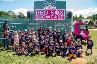 July 26, 2016, Boston, MA: Boston Red Sox catcher Blake Swihart and pitcher Robbie Ross Jr. pose for a photograph with young fans during a Sox Talk clinic with the T-Mobile Mobile Red Sox Showcase Truck at Billings Field in West Roxbury, Massachusetts Tuesday, July 26, 2016. (Photo by Billie Weiss/Boston Red Sox)