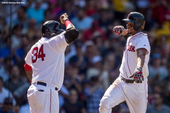 BOSTON, MA - JULY 27: Xander Bogaerts #2 of the Boston Red Sox reacts with David Ortiz #34 after hitting a home run during the seventh inning of a game against the Detroit Tigers on July 27, 2016 at Fenway Park in Boston, Massachusetts. (Photo by Billie Weiss/Boston Red Sox/Getty Images) *** Local Caption *** Xander Bogaerts; David Ortiz