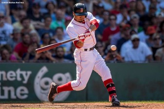 BOSTON, MA - JULY 27: Mookie Betts #50 of the Boston Red Sox hits a triple during the eighth inning of a game against the Detroit Tigers on July 27, 2016 at Fenway Park in Boston, Massachusetts. (Photo by Billie Weiss/Boston Red Sox/Getty Images) *** Local Caption *** Mookie Betts