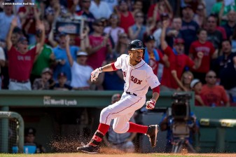 BOSTON, MA - JULY 27: Mookie Betts #50 of the Boston Red Sox pulls up as he rounds third base after hitting a triple during the eighth inning of a game against the Detroit Tigers on July 27, 2016 at Fenway Park in Boston, Massachusetts. (Photo by Billie Weiss/Boston Red Sox/Getty Images) *** Local Caption *** Mookie Betts