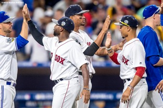 July 12, 2016, San Diego, CA: Boston Red Sox center fielder Jackie Bradley Jr., shortstop Xander Bogaerts, and right fielder Mookie Betts high fives as they celebrate a victory during the 2016 Major League Baseball All-Star Game at PETCO Park in San Diego, California Tuesday, July 12, 2016. (Photos by Billie Weiss/Boston Red Sox)