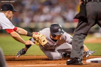 BOSTON, MA - AUGUST 9: Brock Holt #12 of the Boston Red Sox tags out Chase Headley #12 of the New York Yankees during the seventh inning of a game on August 9, 2016 at Fenway Park in Boston, Massachusetts. (Photo by Billie Weiss/Boston Red Sox/Getty Images) *** Local Caption *** Brock Holt; Chase Headley