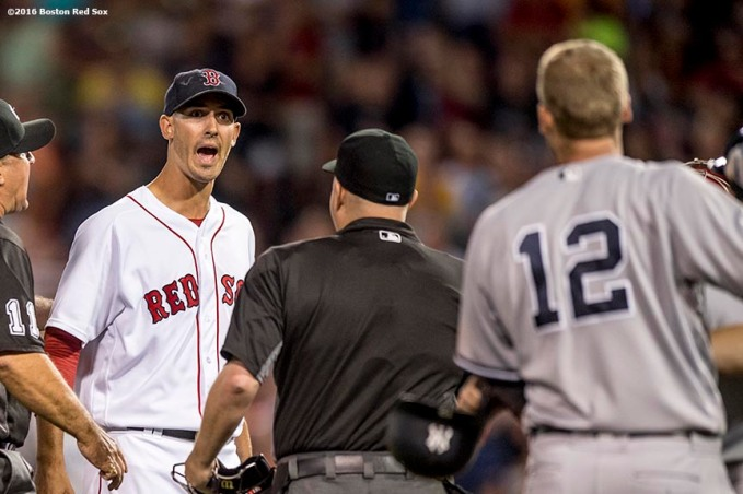 BOSTON, MA - AUGUST 9: Rick Porcello #22 of the Boston Red Sox yells at Chase Headley #12 of the New York Yankees after Headley was tagged out at third base during the seventh inning of a game on August 9, 2016 at Fenway Park in Boston, Massachusetts. (Photo by Billie Weiss/Boston Red Sox/Getty Images) *** Local Caption *** Chase Headley; Rick Porcello
