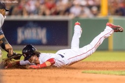BOSTON, MA - AUGUST 9: Andrew Benintendi #40 of the Boston Red Sox slides as he is tagged out at second base during the eighth inning of a game against the New York Yankees on August 9, 2016 at Fenway Park in Boston, Massachusetts. (Photo by Billie Weiss/Boston Red Sox/Getty Images) *** Local Caption *** Andrew Benintendi