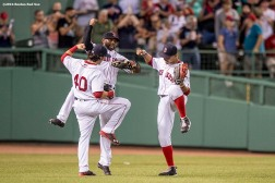 BOSTON, MA - AUGUST 9: Andrew Benintendi #40, Jackie Bradley Jr. #25, and Mookie Betts #50 of the Boston Red Sox celebrate a victory against the New York Yankees on August 9, 2016 at Fenway Park in Boston, Massachusetts. (Photo by Billie Weiss/Boston Red Sox/Getty Images) *** Local Caption *** Andrew Benintendi; Jackie Bradley Jr.; Mookie Betts