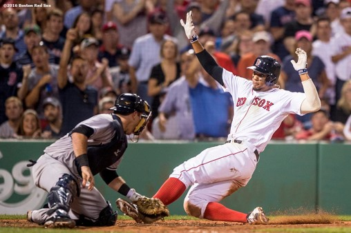 BOSTON, MA - AUGUST 10: Xander Bogaerts #2 of the Boston Red Sox slides into home plate as he is tagged out by Austin Romine #27 of the New York Yankees during the sixth inning of a game on August 10, 2016 at Fenway Park in Boston, Massachusetts. (Photo by Billie Weiss/Boston Red Sox/Getty Images) *** Local Caption *** Xander Bogaerts; Austin Romine