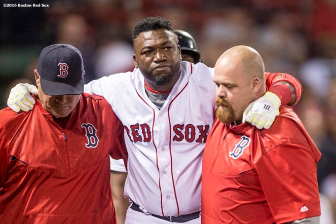 BOSTON, MA - AUGUST 10: David Ortiz #34 of the Boston Red Sox reacts with manager John Farrell and trainer Adam Thomas after hitting a foul ball off his foot, forcing him to leave the game, during the ninth inning of a game against the New York Yankees on August 10, 2016 at Fenway Park in Boston, Massachusetts. (Photo by Billie Weiss/Boston Red Sox/Getty Images) *** Local Caption *** David Ortiz; John Farrell; Adam Thomas
